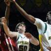 Baylor's Ekpe Udoh, right, reaches for a loose rebound against Oklahoma's Willie Warren, left, in the first half of an NCAA college basketball game Saturday, Jan. 9, 2010, in Waco, Texas. Looking on for Baylor is Josh Lomers (50). (AP Photo/Waco Tribune Herald, Rod Aydelotte)