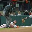 Clemson's Garrett Boulware, center, looks up at umpire Jack Cox, left, for the call after being tagged out at third by South Carolina third baseman Chase Vergason in an NCAA college baseball game on Friday, March 1, 2013, in Clemson, S.C. (AP Photo/Anderson Independent-Mail, Mark Crammer)  GREENVILLE NEWS OUT, SENECA NEWS OUT