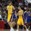 Los Angeles Lakers' Pau Gasol, (16), of Spain, and Steve Nash talk during the first half of a preseason NBA basketball game the Golden State Warriors in Fresno, Calif., Sunday, Oct. 7, 2012. (AP Photo/Gary Kazanjian)