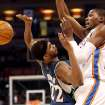 Oklahoma City's Kevin Durant is fouled by Minnesota's Corey Brewer during their NBA basketball game at the Ford Center in downtown Oklahoma City on Sunday, April 4, 2010. The Thunder beat the Timberwolves 116-108. Photo by John Clanton, The Oklahoman ORG XMIT: KOD