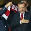 Turkish Prime Minister Recep Tayyip Erdogan gestures before Turkey's World Cup qualifying soccer match against Romania at Sukru Saracoglu Stadium in Istanbul, Turkey, Friday, Oct. 12, 2012. (AP Photo)