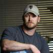"""In this April 6, 2012, photo, former Navy SEAL and author of the book """"American Sniper"""" poses in Midlothian, Texas. A Texas sheriff has told local newspapers that Chris Kyle has been fatally shot along with another man on a gun range, Saturday, Feb. 2, 2013. (AP Photo/The Fort Worth Star-Telegram, Paul Moseley)"""