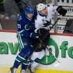 Vancouver Canucks' Alexander Edler, of Sweden, left, checks San Jose Sharks' Jason Demers during second period NHL hockey action in Vancouver, British Columbia, on Thursday Nov. 14, 2013. (AP Photo/The Canadian Press, Darryl Dyck)