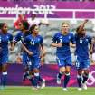 France's Elodie Thomis, right, celebrates her goal with her teammates during the group G women's soccer match against Colombia at St. James' Park in Newcastle, England, during the London 2012 Summer Olympics, Tuesday, July 31, 2012. (AP Photo/Scott Heppell)