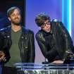 Dan Auerbach, left, and Patrick Carney accept the award for best rock album