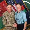 FILE - This July 13, 2011, file photo, provided by the International Security Assistance Force's Flickr website shows the former Commander of International Security Assistance Force and U.S. Forces-Afghanistan Gen. Davis Petraeus, left, shaking hands with Paula Broadwell, co-author of his biography
