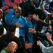 FINAL REGULAR SEASON HOME GAME: The Hornets' Chris Paul, center, slaps hands with the fans as he makes his way through the stands before the start of the NBA basketball game between the New Orleans/Oklahoma City Hornets and the Denver Nuggets at the Ford Center in Oklahoma City, Friday, April 13, 2007. By Nate Billings, The Oklahoman  ORG XMIT: KOD