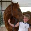 Taylor Williams, son of Lesa and Norman Crowe, receives a kiss from Buddy the horse. Taylor is involved in the horseriding program at Peaceful Heart Equine Ranch located at Triple X and Beau Kay.  Community Photo By:  Lesa Crowe  Submitted By:  Lesa, Midwest City