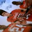 Oklahoma State quarterback Zac Robinson signs a poster for a fan during OSU's Fan Appreciation Day on Saturday in Stillwater. (Photo by John Clanton, The Oklahoman)