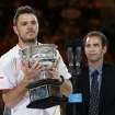 Stanislas Wawrinka of Switzerland holds the trophy after defeating Rafael Nadal of Spain, beside Pete Sampras,  in the men's singles final at the Australian Open tennis championship in Melbourne, Australia, Sunday, Jan. 26, 2014.(AP Photo/Aaron Favila)