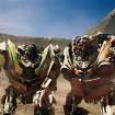 In this film publicity image released by Paramount Pictures, twin robots, Skids, left, and Mudflap are shown in a scene from,