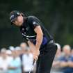 Rory McIlroy of Northern Ireland makes a birdie putt on the 13th hole of The Barclays PGA golf tournament at Bethpage State Park in Farmingdale, N.Y., Thursday, Aug. 23, 2012. (AP Photos/Henny Ray Abrams)