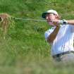 Ernie Els, of South Africa, hits out of the rough on the 10th hole during the first round of The Barclays golf tournament at Bethpage State Park in Farmingdale, N.Y., Thursday, Aug. 23, 2012. (AP Photos/Henny Ray Abrams)