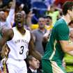 Boston Celtics center Kris Humphries (43) celebrates in front of New Orleans Pelicans guard Anthony Morrow (3) after scoring a last second basket to force the game into overtime during an NBA basketball game in New Orleans, Sunday, March 16, 2014. The Pelicans won 121-120. (AP Photo/Jonathan Bachman)