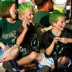 Carson Speer, (center) and Shannee Faye and Tate Tettleton ride in the parade as Norman North students, athletes and fans show their enthusiasm at the Homecoming Parade the day before their game with Putnam City North in Norman, Oklahoma on Thursday, September 25, 2008.  Speer is the son of a Norman North coach and the Tettleton's brother is quarterback Tyler Tettleton.   BY STEVE SISNEY, THE OKLAHOMAN
