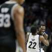 Memphis Grizzlies forward Rudy Gay (22) hugs teammate Tony Allen after stopping a shot by the San Antonio Spurs in overtime during an NBA basketball game on Friday, Jan. 11, 2013, in Memphis, Tenn. Memphis won in overtime 101-98. (AP Photo/Lance Murphey)