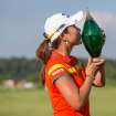 Hee Young Park, of South Korea, kisses the trophy following her victory on the third hole of a playoff in the Manulife Financial LPGA Classic golf tournament in Waterloo, Ontario, Sunday, July 14, 2013. (AP Photo/The Canadian Press, Geoff Robins)