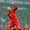 Munich's Arjen Robben of the Netherlands celebrates after scoring during the German first division Bundesliga soccer match between FC Bayern Munich and SV Hamburg  in Munich, Germany, Saturday, March 30, 2013. (AP Photo/Kerstin Joensson)