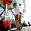 Chase Ogletree, age 9, of Walters, Okla., tries a game on the Midway at the 2009 Oklahoma State Fair at State Fair Park in Oklahoma City on Sunday, Sept. 27, 2009.  By John Clanton, The Oklahoman