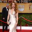 Isla Fisher arrives at the 20th annual Screen Actors Guild Awards at the Shrine Auditorium on Saturday, Jan. 18, 2014, in Los Angeles. (Photo by Jordan Strauss/Invision/AP)
