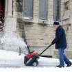 Dave Black uses a snow blower to clear snow from the sidewalks at St. Paul's Episcopal Church on First Street in Evansville, Ind., on Thursday, Dec. 27, 2012. (AP Photo/The Evansville Courier & Press, Erin McCracken)