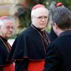Cardinal Odilo Pedro Scherer, of Brazil, center, is followed by compatriot Cardinal Geraldo Majella Agnelo, left, as they arrive for a meeting, at the Vatican, Monday, March 4, 2013. Cardinals from around the world have gathered inside the Vatican for their first round of meetings before the conclave to elect the next pope, amid scandals inside and out of the Vatican and the continued reverberations of Benedict XVI's decision to retire. (AP Photo/Andrew Medichini)