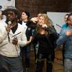 The Black Eyed Peas members, from left, will.i.am, Fergie and apl.de.ap sing with students at the launch of a new Peapod Adobe Youth Voices Academy in New York, Tuesday, April 19, 2011. (AP Photo/Charles Sykes)
