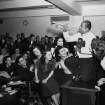 FILE - In this March 12, 1941, file photo, Louis Armstrong, wearing a Brooklyn College sweater, performs on the campus in New York as the school honored him with the degree