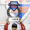 Tony Kanaan holds the winners trophy after winning the IndyCar Series season final 500 mile auto race Saturday, Aug. 30, 2014, at Auto Club Speedway, in Fontana, Calif. (AP Photo/Will Lester)