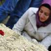 A woman at the grave of a mine accident victim in Soma, Turkey, Wednesday, May 14, 2014. Rescuers desperately raced against time to reach more than 200 miners trapped underground Wednesday after an explosion and fire at a coal mine killed at least 245 workers, Energy Minister Taner Yildiz said Wednesday.(AP Photo/Emre Tazegul)