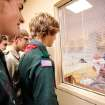Boy Scouts from Troop 21 look through a viewing window at Ryson Wilson, who was born to Rocky and Rayna Wilson, of Guthrie, on Oct. 4 at Integris Health Edmond. PHOTO BY JIM BECKEL, THE OKLAHOMAN ARCHIVES