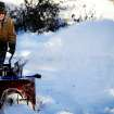 Bill Earley clears his driveway during Thursday's cold snap in Sioux Falls, S.D., on Thursday, Dec. 5, 2013. Winter storm and ice warnings are in effect through much of today for parts of six states in the Midwest. (AP Photo/Argus Leader, Joe Ahlquist)