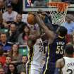 Indiana Pacers center Roy Hibbert (55) blocks a shot by Utah Jazz forward Paul Millsap (24) in the first half during an NBA basketball game on Saturday, Jan. 26, 2013, in Salt Lake City. (AP Photo/Steve C. Wilson)
