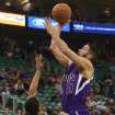 Utah Jazz's Trey Burke (3) defends as Sacramento Kings' guard Greivis Vasquez (10) takes a shot in the first half of an NBA basketball game on Saturday, Dec. 7, 2013, in Salt Lake City. (AP Photo/Kim Raff)