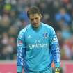 Hamburg's goal keeper Rene Adler reacts during the German first division Bundesliga soccer match between FC Bayern Munich and SV Hamburg  in Munich, Germany, Saturday, March 30, 2013. (AP Photo/Kerstin Joensson)