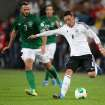 Germany's Mesut Ozil, right, and Ireland's Marc Wilson challenge for the ball during a Group C World Cup qualifying match between Germany and Ireland in Cologne, Germany, Friday, Oct.11, 2013. (AP Photo/Michael Probst)