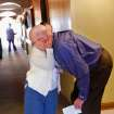 Jim O'Brien, right,  is hugged by Sharon Thompson,  one of his residents, in a hallway of the 54-bed  facility, Center of Family Love, a group home for mentally disabled people, in Okarche on Monday, Jan. 18, 2010.  O'Brien is the center's executive director.  Photo by Jim Beckel, The Oklahoman