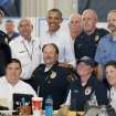President Barack Obama poses for a photo with first responders at a Fire Station in Moore, Okla., on Sunday, May 25, 2013. Photo by Bryan Terry The Oklahoman