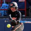Oklahoma State Cowgirl Shelby Davis swings at a pitch during the Oklahoma State - Iowa game at