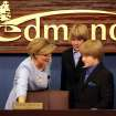 Edmond Mayor Patrice Douglas and her sons Patrick, 14, and Phillip, 11, (right) look at her new chair at the council chambers during a ceremony at  Edmond's Council Chambers in Edmond on Monday, May 4, 2009. Photo by John Clanton, The Oklahoman