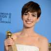 FILE - In this Jan. 13, 2013 file photo, Anne Hathaway poses with the award for best performance by an actress in a supporting role in a motion picture in