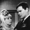 FILE - This 1967 file photo shows Barbara Eden, left, and Larry Hagman in a scene from the television show