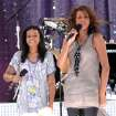 FILE - In this Sept. 1, 2009 file photo, singer Whitney Houston, right, sings with her daughter Bobbi Kristina Brown during a performance on 'Good Morning America' in Central Park in New York. Whitney Houston, who reigned as pop music's queen until her majestic voice and regal image were ravaged by drug use, has died, Saturday, Feb. 11, 2012. She was 48. (AP Photo/Evan Agostini, File) ORG XMIT: NY136