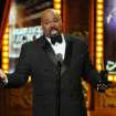 "James Monroe Iglehart accepts the award for best performance by an actor in a featured role in a musical for ""Aladdin"" at the 68th annual Tony Awards at Radio City Music Hall on Sunday, June 8, 2014, in New York. (Photo by Evan Agostini/Invision/AP)"