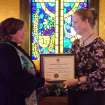 Julie Murray, right, Girl Scout Troop Leader and Service Unit Director, Red Lands Council, presents Rev. Glenda Skinner-Noble, Pastor of Harrah United Methodist Church, with a appreciation plaque on Nov. 12. The Girls Scouts thanked the church membership for its providing a place for meetings and support. Murray said that for one special meeting in December there will be 150 Scouts creating Christmas ornaments in the church's Fellowship Hall.  Community Photo By:  Lin Archer  Submitted By:  Lin, Harrah