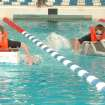 Blake Wallen (left) and Cory Cockerham from Mustang North Middle School race for the finish line at the pool at Oklahoma City Community College. Every year seventh-grade students at Mustang North Middle School enjoy a