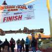 The Iditarod Trial Sled Dog Race finish banner is raised above the burled arch finish line in Nome, Alaska, on Monday, March 10, 2014. The race winner is expected some time early Tuesday, March 11, 2014. (AP Photo/Mark Thiessen)