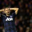 Manchester United's Ryan Giggs holds his head after being defeated by Sunderland at the end of their English League Cup semifinal first leg soccer match at the Stadium of Light, Sunderland, England, Tuesday, Jan. 7, 2014. (AP Photo/Scott Heppell)