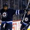 Winnipeg Jets' Dustin Byfuglien, left, celebrates a power-play goal against the Tampa Bay Lightning during the second period of an NHL hockey game Tuesday, Jan. 7, 2014, in Winnipeg, Manitoba. (AP Photo/The Canadian Press, Trevor Hagan)
