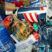 FILE - In this Aug. 2006 file photo, a trash can sits loaded with various health and beauty aids and beverages from passengers forced to discard these items at the Buffalo-Niagara International Airport in Cheektowaga, N.Y. After a man was arrested at Los Angeles International Airport wearing a bulletproof vest, flame-resistant pants and had a suitcase full of weapons, the TSA has restated what air travelers are allowed to bring along. (AP Photo/The Buffalo News, Robert Kirkham) TV OUT; MAGS OUT; MANDATORY CREDIT; BATAVIA DAILY NEWS OUT; DUNKIRK OBSERVER OUT; JAMESTOWN POST-JOURNAL OUT; LOCKPORT UNION-SUN JOURNAL OUT; NIAGARA GAZETTE OUT; OLEAN TIMES-HERALD OUT; SALAMANCA PRESS OUT; TONAWANDA NEWS OUT (REV-SHARE)